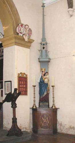 Statue of Our Lady with canopy. Note the Travers-designed hymn board and numbers